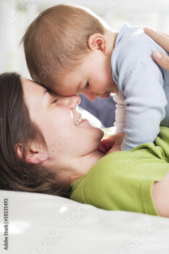 Tender moments: Joyful mother embracing her son with love.