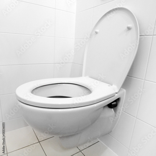 Toilet bowl in a modern bathroom.