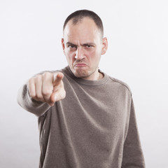 angry man accusing you, pointing finger at you!