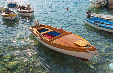 Wooden fishing boats float moored in Adriatic sea