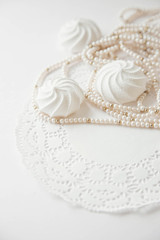 Wedding background with meringue cake and beads