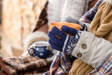 Winter hot tea hands holding steaming mug