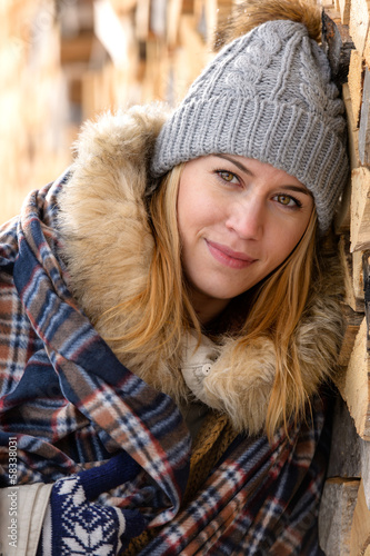 Young woman in winter jacket cover blanket