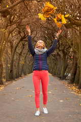Happiness expression in autumnal park scenery