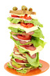 tall sandwich with ham salad and cheese on white background