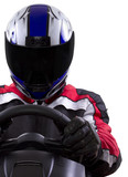 racerwearing red racing suit and blue helmet on a steering wheel