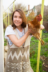 Girl holding a chicken