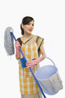 Woman holding a mop and a bucket