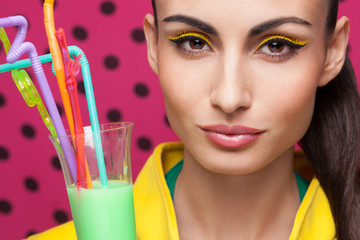Colorful Closeup of beautiful model with cocktail