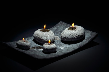 burning candles isolated on black background