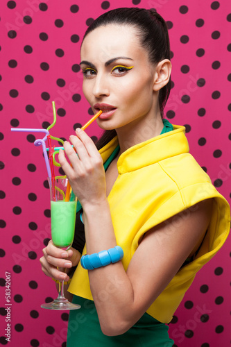 Fashionable Woman with colorful cocktail