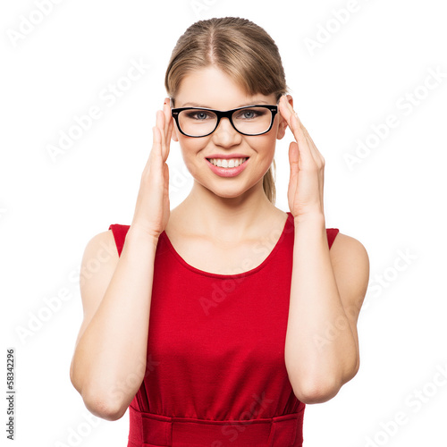 Smiling fashion woman touching her optical glasses, isolated