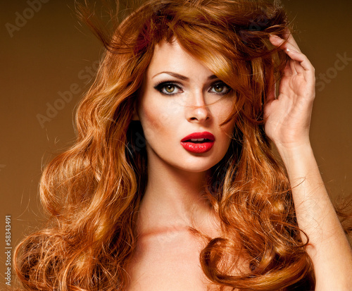 Red Hair. Fashion Girl Portrait. long  Hair and red lipstick.