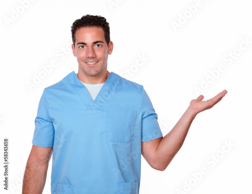Handsome male nurse holding his left palm