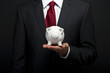 Businessman with piggy bank over dark background