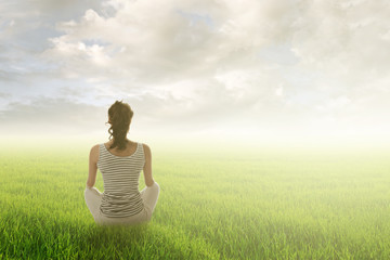 woman sit on grassland