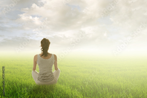 woman sit on grassland