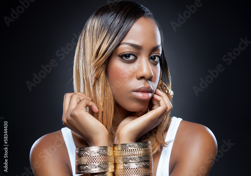 Black beauty wearing golden accessories
