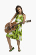 Woman playing a guitar and posing