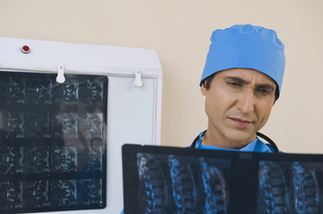 Surgeon examining an x-ray report