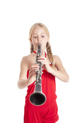 young girl in red playing clarinet