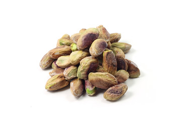 pistachio kernels on a white background