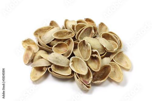The shell pistachios on a white background