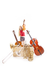 young girl with many musical instruments in box