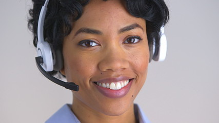 Smiling African American call center representative