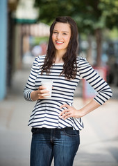 Woman Holding Coffee Cup Outdoors