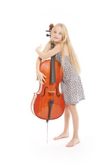 young girl in dress embracing her cello
