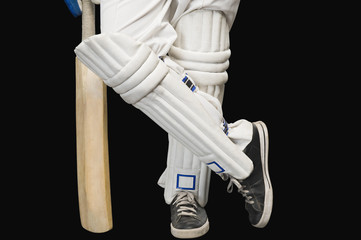 Low section view of a cricket batsman standing at a non-striker end