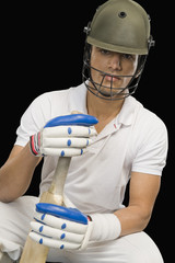 Portrait of a cricket batsman with a cricket bat