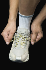 Athlete tying his shoelaces