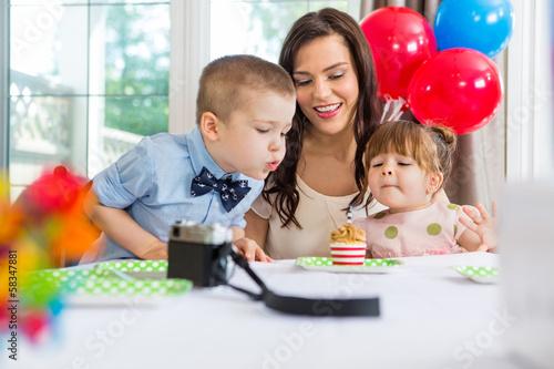 Family Celebrating Boy's Birthday
