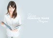 Smiling brunette in white shirt with book