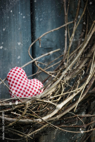Little heart on Christmas wreath