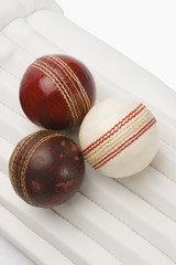 Close-up of cricket balls on cricket pads