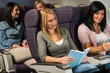 Young woman passenger read book airplane flight