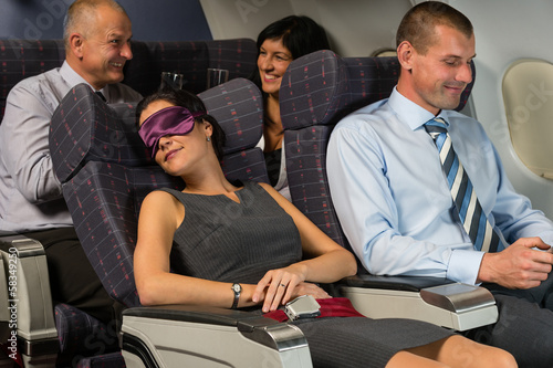 Business woman sleep during flight airplane cabin