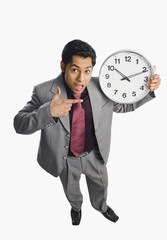 Businessman showing a clock