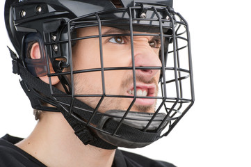 Close up of Angry male face in black hockey mask.