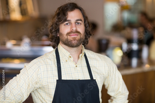 Confident Owner Standing In Espresso Bar