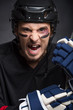 Portrait of hockey player with screaming angry look.