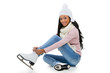 Smiling  woman wearing skates while sitting on the floor.