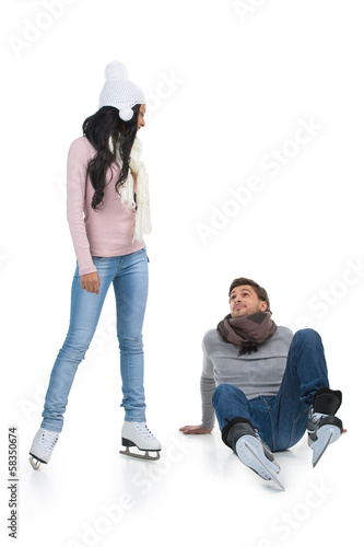 Mixed race couple skating at the skating rink.