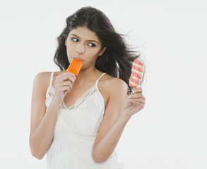Close-up of a woman eating an ice cream