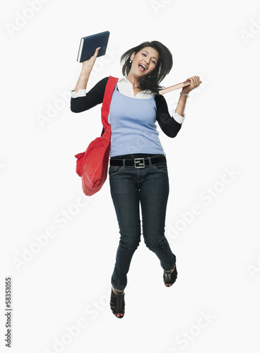 University student holding books and looking excited