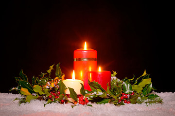 Christmas candles with garland,