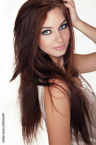 Young girl with blue eyes and long hair isolated on white backgr